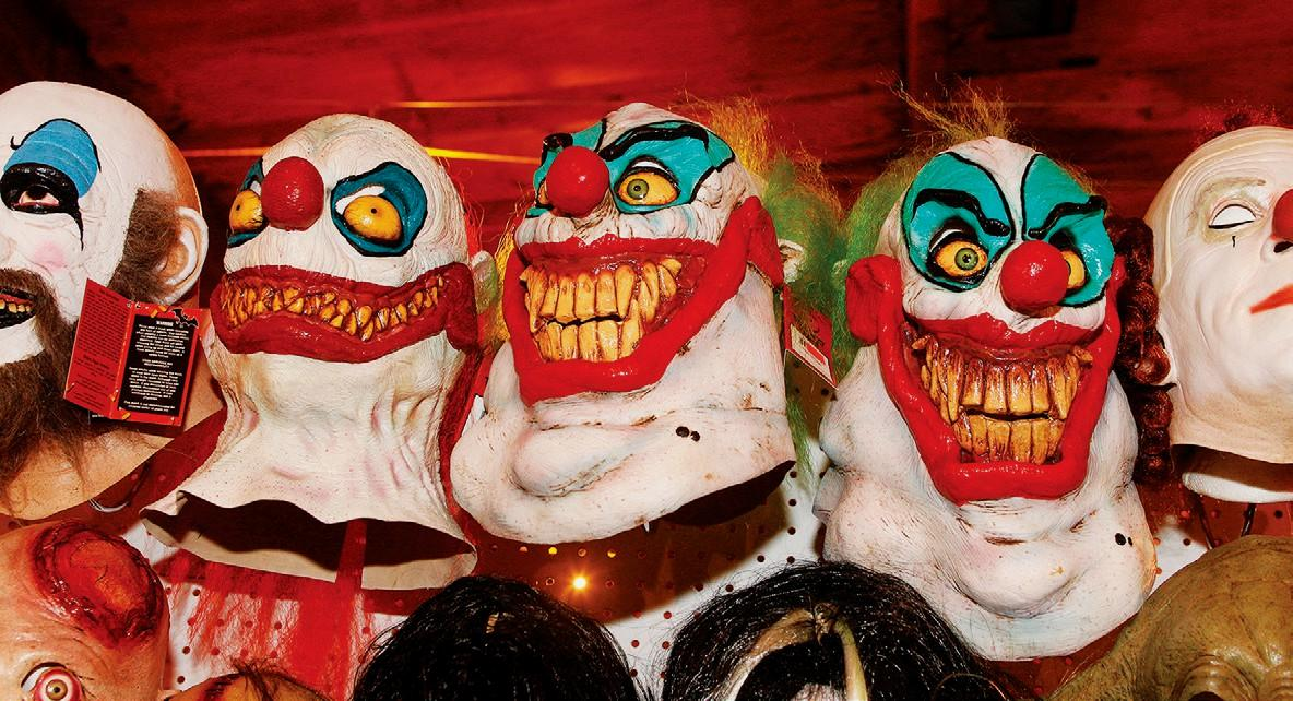dark comedynightmare inducing clown masks are on display at the best halloween store